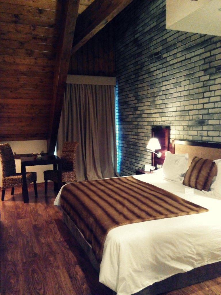 Habitaciones con techos de madera en el Pirineo aragonés - Hotel El Privilegio de Tena